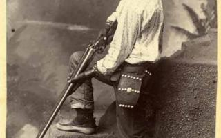 Isleta man with shotgun